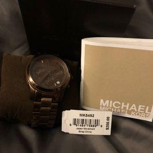 Women's brown Michael Kors watch